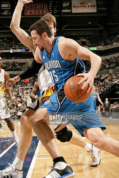 Hedo Turkoglu of the Orlando Magic drives past Mike Dunleavy of the Indiana Pacers at Conseco Fieldhouse on February 6 2009 in Indianapolis Indiana...