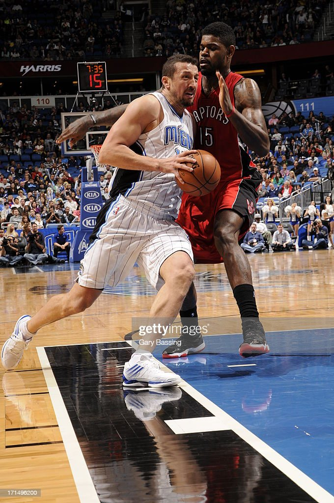 Hedo Turkoglu #15 of the Orlando Magic drives to the basket against Amir Johnson #15 of the Toronto Raptors on December 29, 2012 at Amway Center in Orlando, Florida.