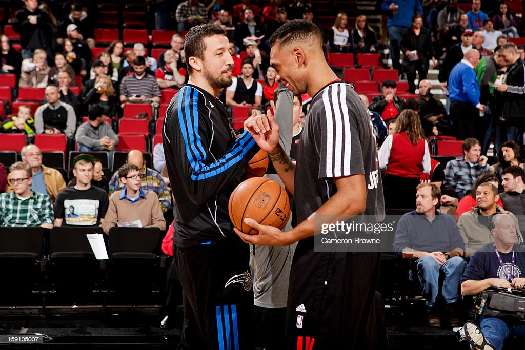 Hedo Turkoglu #15 of the Orlando Magic greets Jared Jeffries #1 of the Portland Trail Blazers before their game on January 7, 2013 at the Rose Garden Arena in Portland, Oregon.