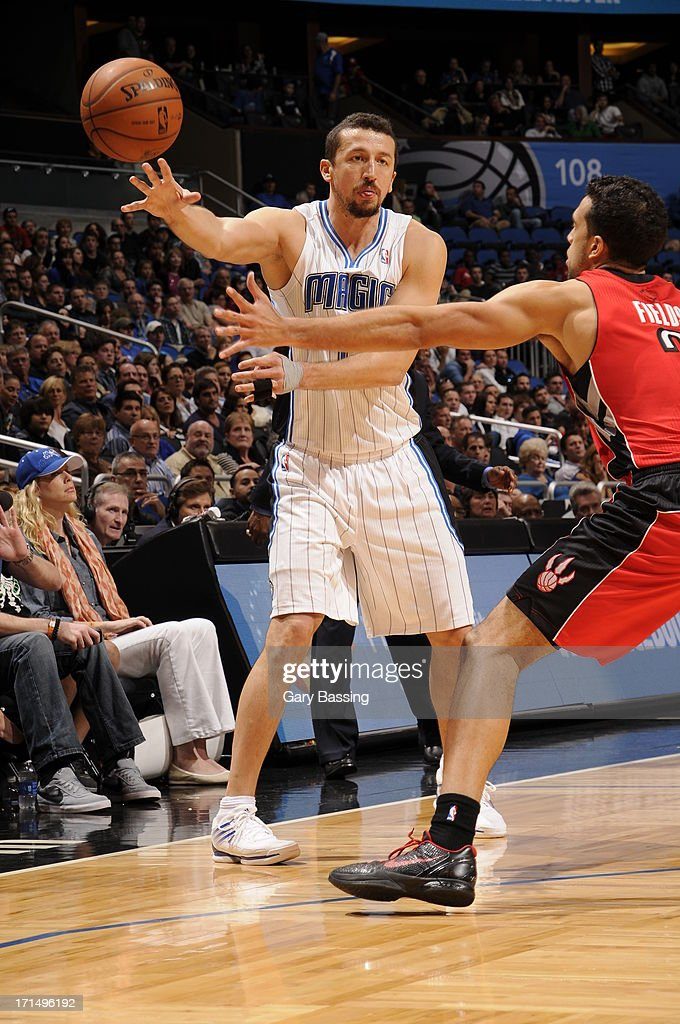 Hedo Turkoglu #15 of the Orlando Magic makes a pass against the Toronto Raptors on December 29, 2012 at Amway Center in Orlando, Florida.