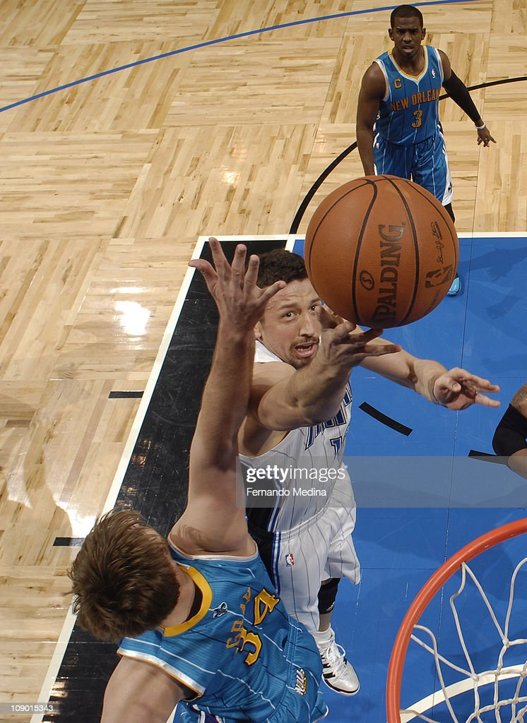 <a gi-track='captionPersonalityLinkClicked' href=/galleries/search?phrase=Hedo+Turkoglu&family=editorial&specificpeople=201639 ng-click='$event.stopPropagation()'>Hedo Turkoglu</a> #15 of the Orlando Magic shoots against <a gi-track='captionPersonalityLinkClicked' href=/galleries/search?phrase=Aaron+Gray+-+Basketball+Player&family=editorial&specificpeople=666453 ng-click='$event.stopPropagation()'>Aaron Gray</a> #34 of the New Orleans Hornets during the game on February 11, 2011 at the Amway Center in Orlando, Florida.