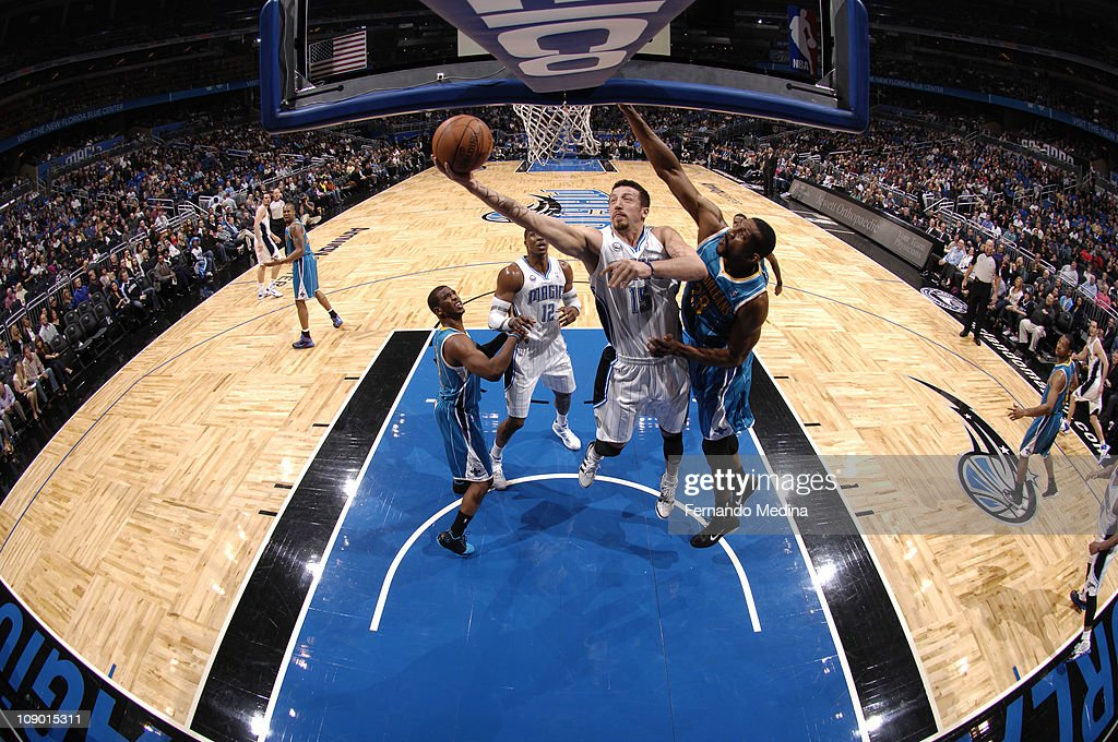 <a gi-track='captionPersonalityLinkClicked' href=/galleries/search?phrase=Hedo+Turkoglu&family=editorial&specificpeople=201639 ng-click='$event.stopPropagation()'>Hedo Turkoglu</a> #15 of the Orlando Magic shoots against D.J. Mbenga #28 of the New Orleans Hornets during the game on February 11, 2011 at the Amway Center in Orlando, Florida.