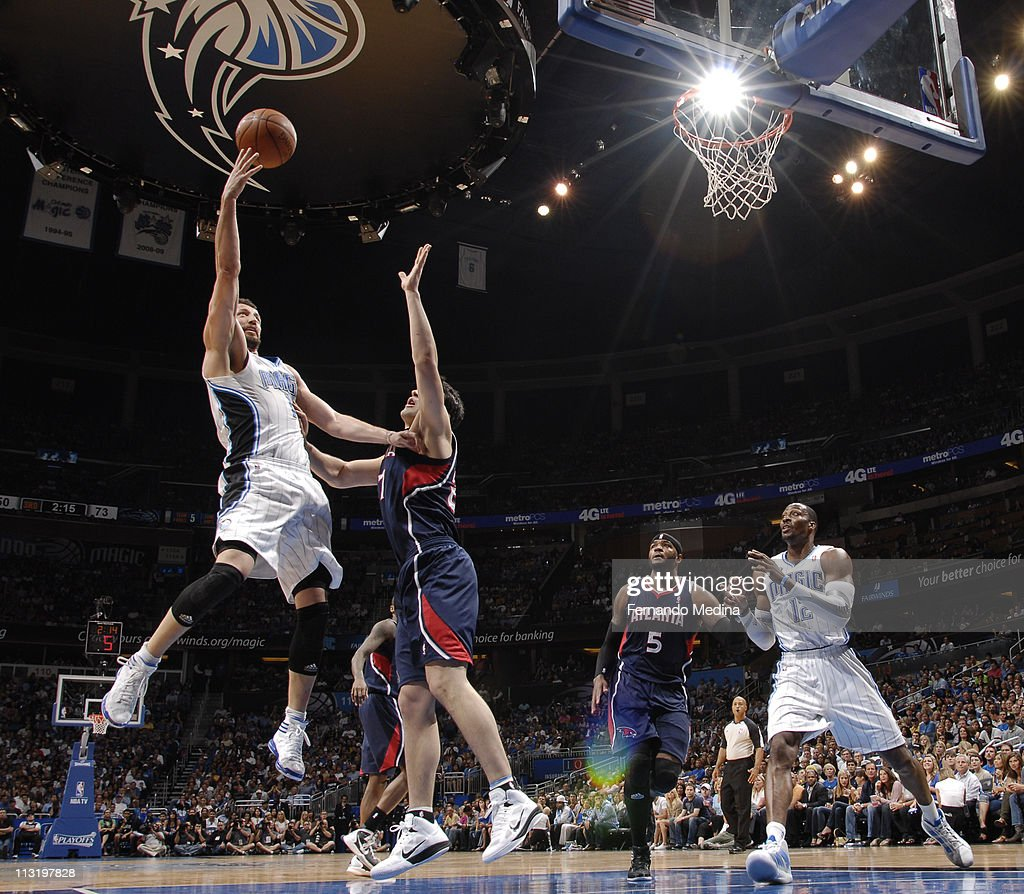 <a gi-track='captionPersonalityLinkClicked' href=/galleries/search?phrase=Hedo+Turkoglu&family=editorial&specificpeople=201639 ng-click='$event.stopPropagation()'>Hedo Turkoglu</a> #15 of the Orlando Magic shoots against <a gi-track='captionPersonalityLinkClicked' href=/galleries/search?phrase=Zaza+Pachulia&family=editorial&specificpeople=202939 ng-click='$event.stopPropagation()'>Zaza Pachulia</a> #27 of the Atlanta Hawks in Game Five of the Eastern Conference Quarterfinals in the 2011 NBA Playoffs on April 26, 2011 at the Amway Center in Orlando, Florida.