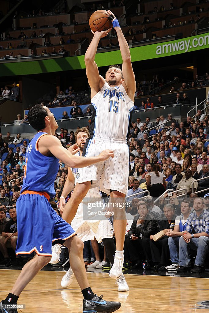<a gi-track='captionPersonalityLinkClicked' href=/galleries/search?phrase=Hedo+Turkoglu&family=editorial&specificpeople=201639 ng-click='$event.stopPropagation()'>Hedo Turkoglu</a> #15 of the Orlando Magic shoots over <a gi-track='captionPersonalityLinkClicked' href=/galleries/search?phrase=Pablo+Prigioni&family=editorial&specificpeople=664673 ng-click='$event.stopPropagation()'>Pablo Prigioni</a> #9 of the New York Knicks during the game on January 5, 2013 at Amway Center in Orlando, Florida.