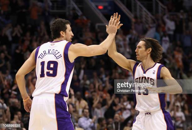 Hedo Turkoglu of the Phoenix Suns highfives teammate Steve Nash after Turkoglu hit a three point shot against the Denver Nuggets during the NBA game...