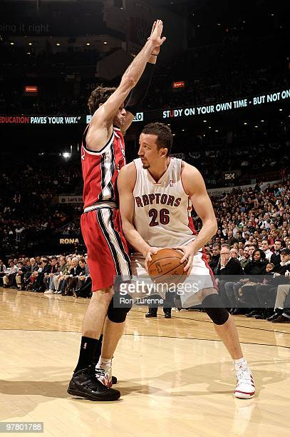 Hedo Turkoglu of the Toronto Raptors handles the ball against Jose Calderon of the Portland Trail Blazers during the game on February 24 2010 at Air...