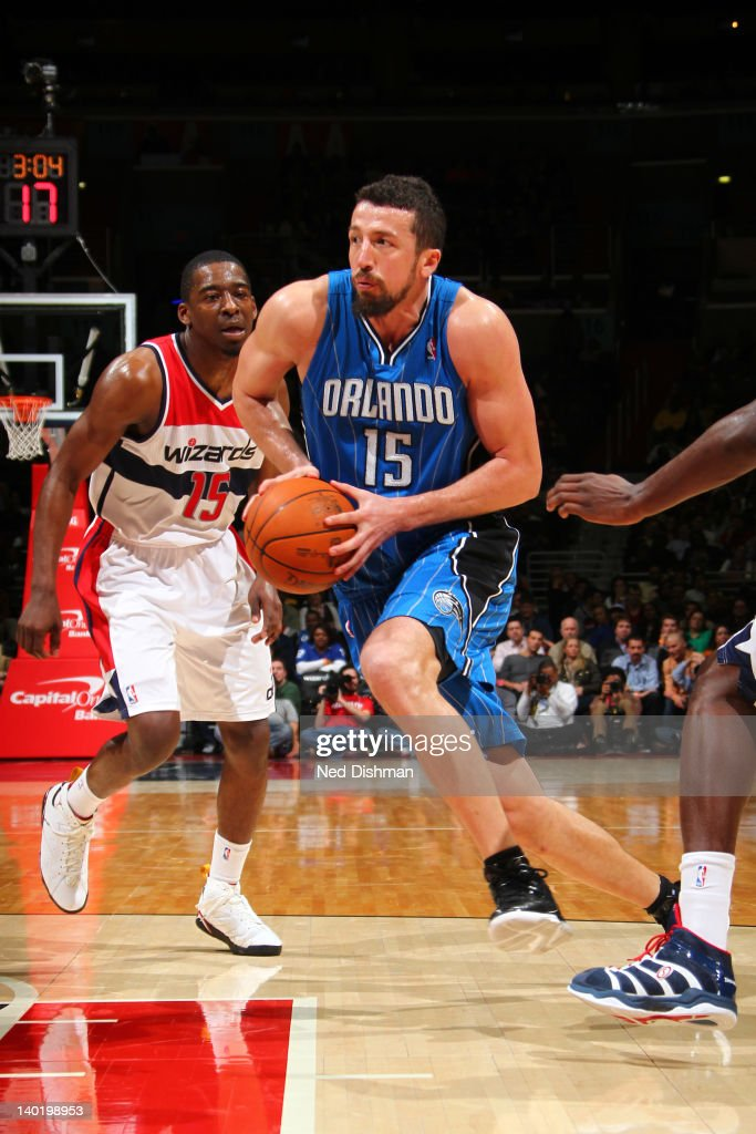 Hedu Terkoglu #15 of the Orlando Magic drives against <a gi-track='captionPersonalityLinkClicked' href=/galleries/search?phrase=Jordan+Crawford&family=editorial&specificpeople=4779380 ng-click='$event.stopPropagation()'>Jordan Crawford</a> #15 of the Washington Wizards during the game at the Verizon Center on February 29, 2012 in Washington, DC.