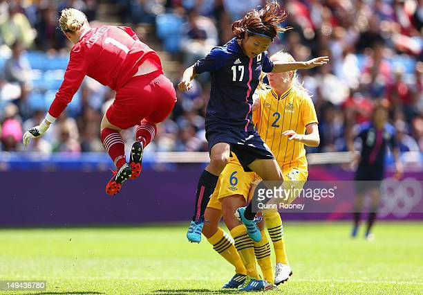 Hedvig Lindahl of Sweden blocks a shot on goal by Yuki Ogimi of Japan during the Women's Football first round Group F Match of the London 2012...