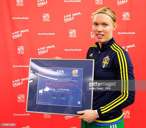 Hedvig Lindahl of Sweden is presented with the player of the match award after the Group D match between United States of America and Sweden of the...