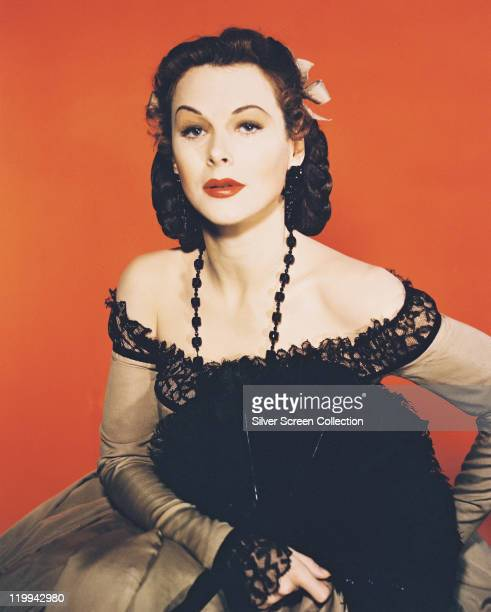 Hedy Lamarr Austrian actress wearing a black shoulderless dress with a black beaded necklace in a studio portrait 1940
