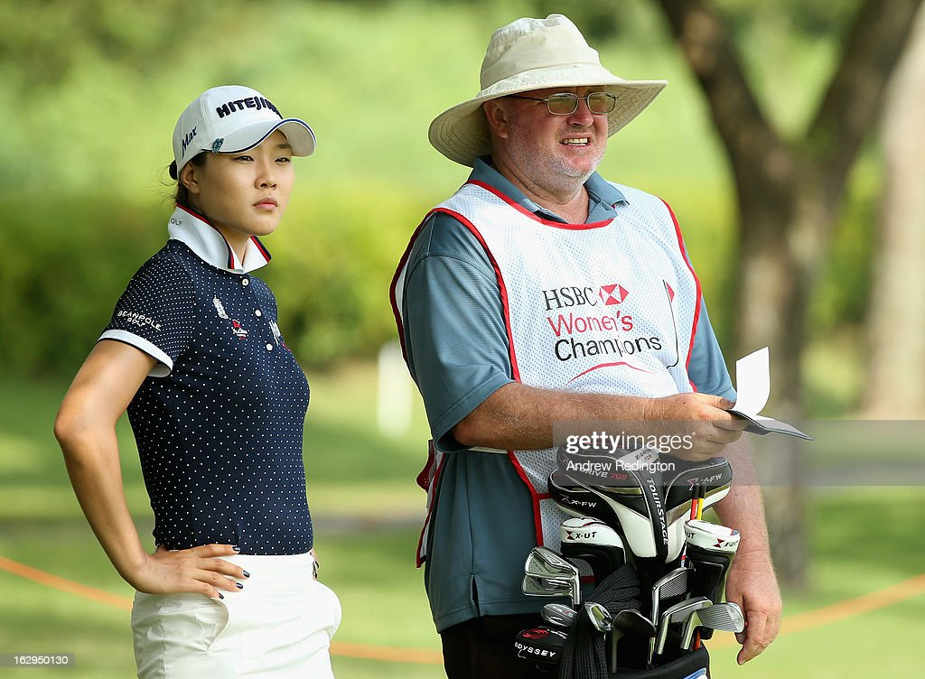 Hee Kyung Seo of South Korea and caddie Dean Herden in action during the third round of the HSBC Women's Champions at the Sentosa Golf Club on March 2, 2013 in Singapore, Singapore.