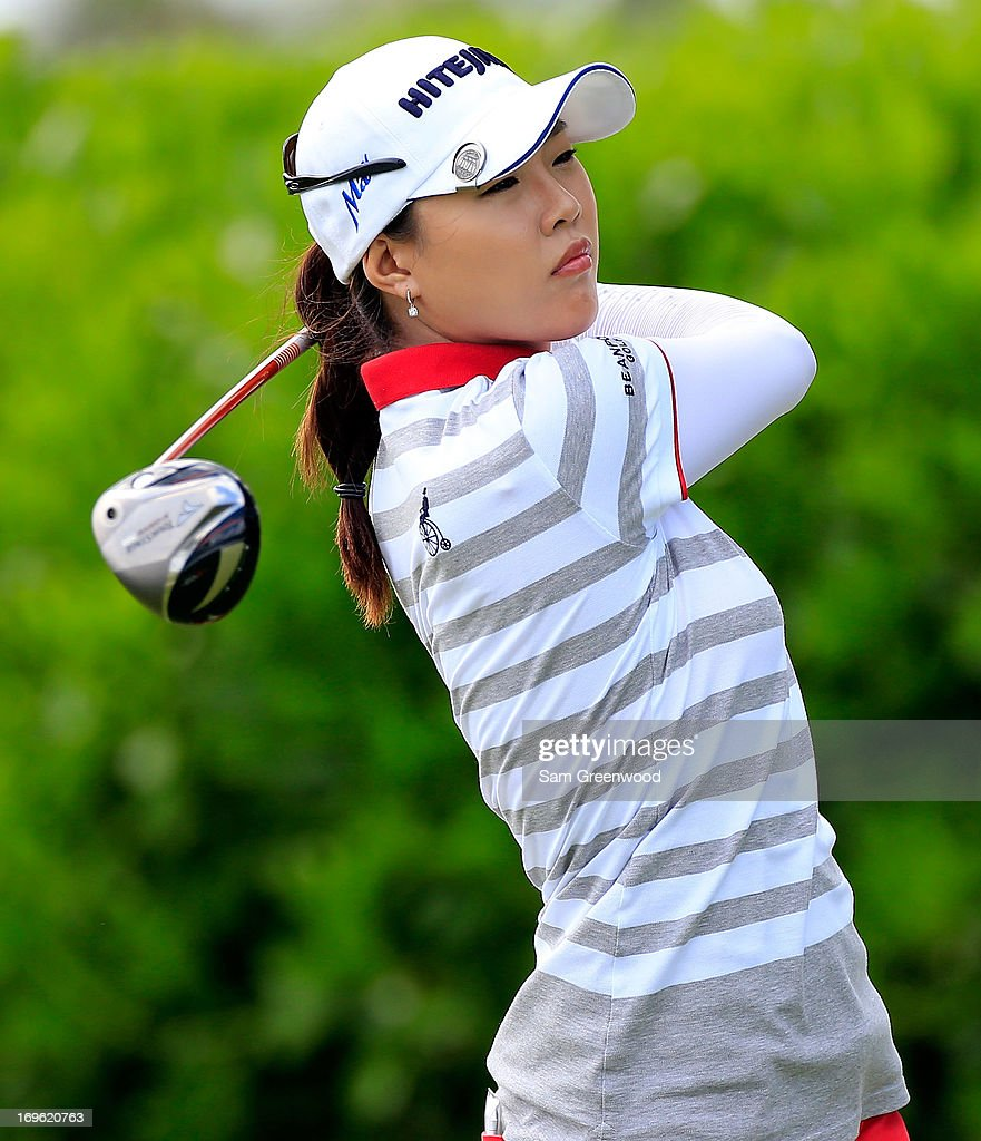 <a gi-track='captionPersonalityLinkClicked' href=/galleries/search?phrase=Hee+Kyung+Seo&family=editorial&specificpeople=5991795 ng-click='$event.stopPropagation()'>Hee Kyung Seo</a> of South Korea hits a shot during the final round of the Pure Silk-Bahamas LPGA Classic at the Ocean Club course on May 26, 2013 in Paradise Island, Bahamas.