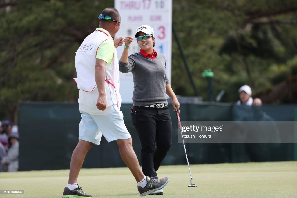 Hee-Kyung Bae of South Korea celebrates after making her birdie putt on the 18th green during the final round of the Daikin Orchid Ladies Golf Tournament at the Ryukyu Golf Club on March 5, 2017 in Nanjo, Japan.