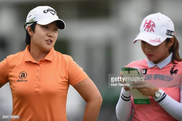 HeeKyung Bae of South Korea speaks with BoMee Lee of South Korea during the final round of the CAT Ladies Golf Tournament HAKONE JAPAN 2017 at the...