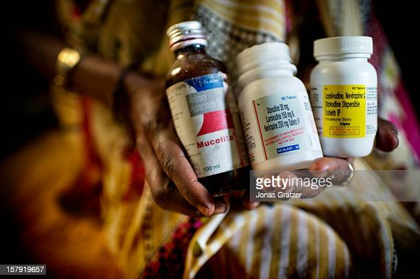 Heer Pardesi who is 42 years old holds her antiretroviral drugs for HIV 'These are the pills that keep me alive Without them I would be dead and my...