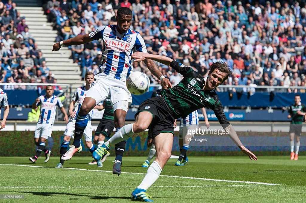 Heerenveen - Fc Groningen. (L+R) Kenneth Otigba of Heerenveen, Etienne Reijnen of FC Groningen, during the Dutch Eredivisie match between sc Heerenveen and FC Groningen at Abe Lenstra Stadium on May 01, 2016 in Heerenveen, The Netherlands