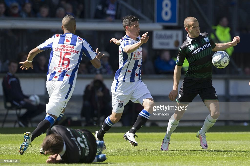 , Heerenveen, Jerry St. Juste of Heerenveen, Arber Zeneli of Heerenveen, Jesper Drost of FC Groningen, during the Dutch Eredivisie match between sc Heerenveen and FC Groningen at Abe Lenstra Stadium on May 01, 2016 in Heerenveen, The Netherlands