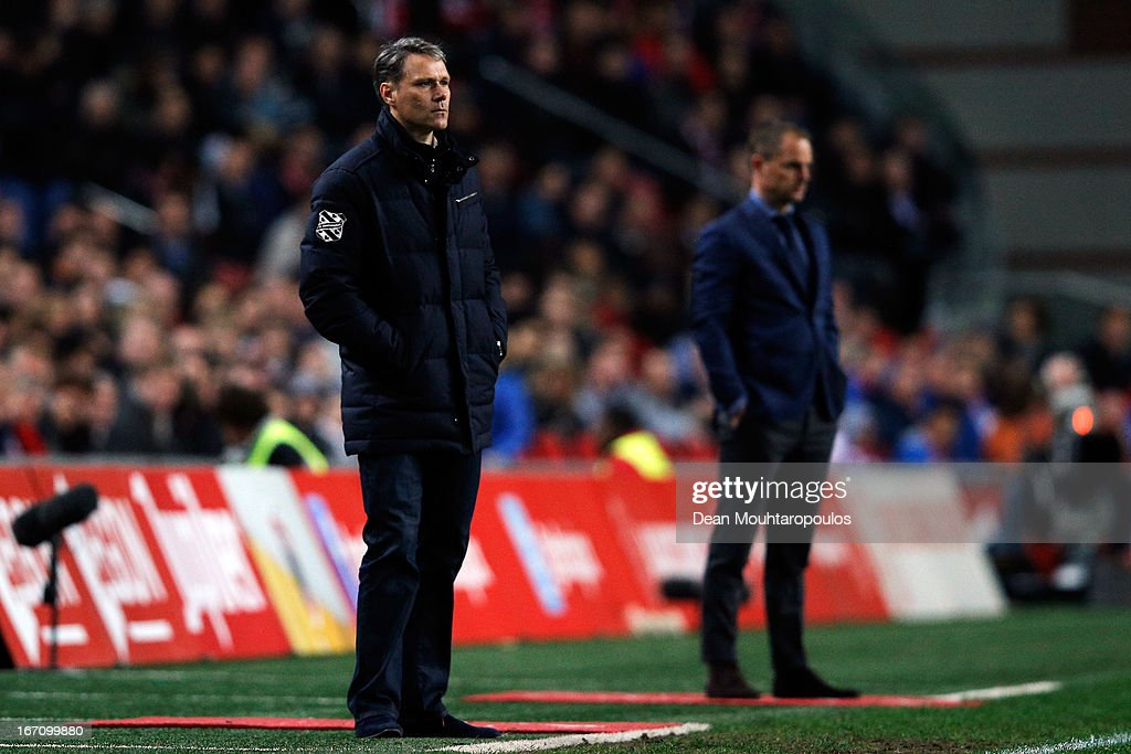 Heerenveen Manager / Coach, Marco van Basten (L) and Ajax Manager / Coach, Frank de Boer watch the action on the sidelines during the Eredivisie match between Ajax Amsterdam and SC Heerenveen at Amsterdam Arena on April 19, 2013 in Amsterdam, Netherlands.