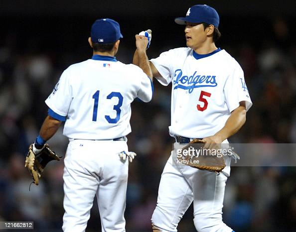 HeeSeop Choi and Oscar Robles of the Los Angeles Dodgers celebrate the final out of 54 victory over the San Diego Padres at Dodger Stadium in Los...