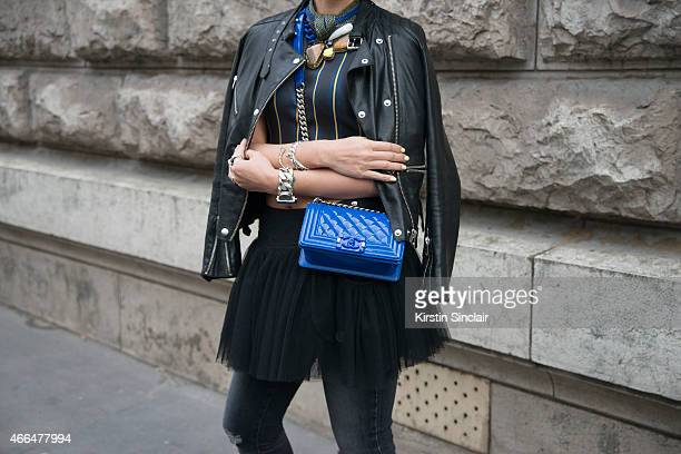 Heewon Kan wears a Jean Paul Gaultier tutu Sandro jacket Clover Canyon top Chanel bag Ann Dexter Johnson bracelet and Hinto Bracelet on day 7 of...