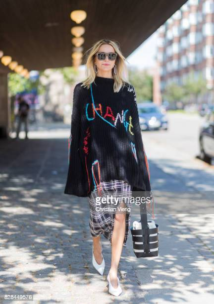 Hege Aurelie Badendyck wearing a knit with the print Change outside Munthe on August 09 2017 in Copenhagen Denmark