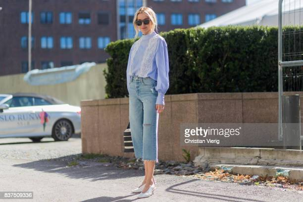 Hege Aurelie Badendyck wearing cropped denim jeans bucket bag outside IBEN on August 22 2017 in Oslo Norway