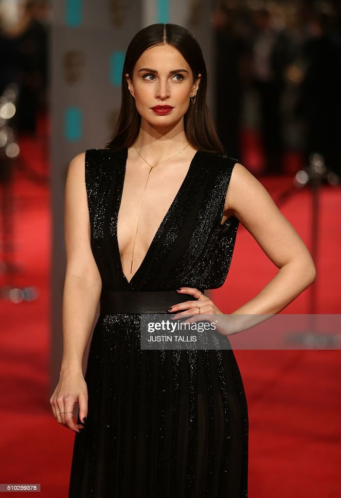 Heida Reed poses on arrival for the BAFTA British Academy Film Awards at the Royal Opera House in London on February 14, 2016. TALLIS