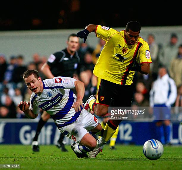 Heidar Helguson of QPR is challenged by Adrian Mariappa of Watford during the npower Championship match between Queens Park Rangers and Watford at...