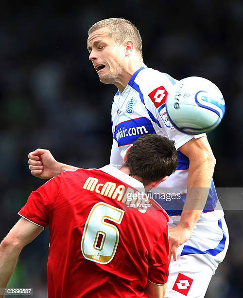 Heidar Helguson of Queens Park Rangers wins the arial battle against Stephen McManus of Middlesbrough during the npower Championship match between...