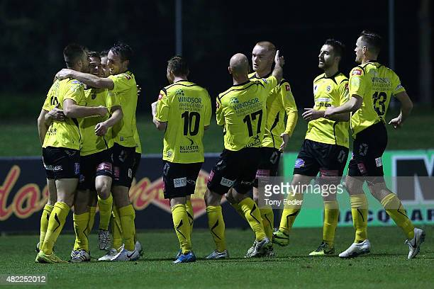 Heidelberg players celebrate a goal during the FFA Cup match between Broadmeadow Magic FC and Heidelberg United FC at Magic Park on July 29 2015 in...