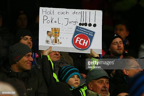 Heidenheim fans enjoy the pre match atmosphere during the DFB Cup quarter final match between 1 FC Heidenheim and Hertha BSC at VoithArena on...