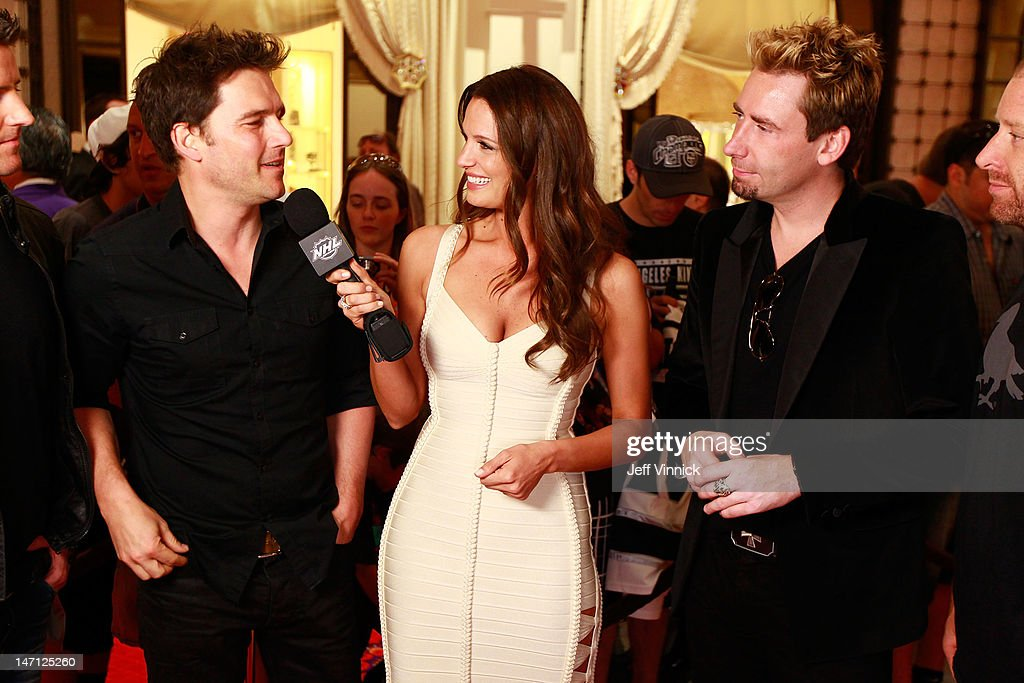 Heidi Androl of the NHL Network interviews members of the band Nickelback as the band arrive before the 2012 NHL Awards at the Encore Theater at the Wynn Las Vegas on June 20, 2012 in Las Vegas, Nevada.