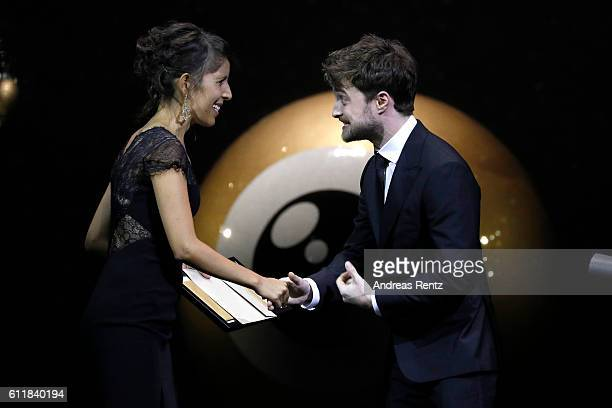 Heidi Brandenburg receives the award for international documentary by Daniel Radcliffe on stage during the Award Night Ceremony during the 12th...