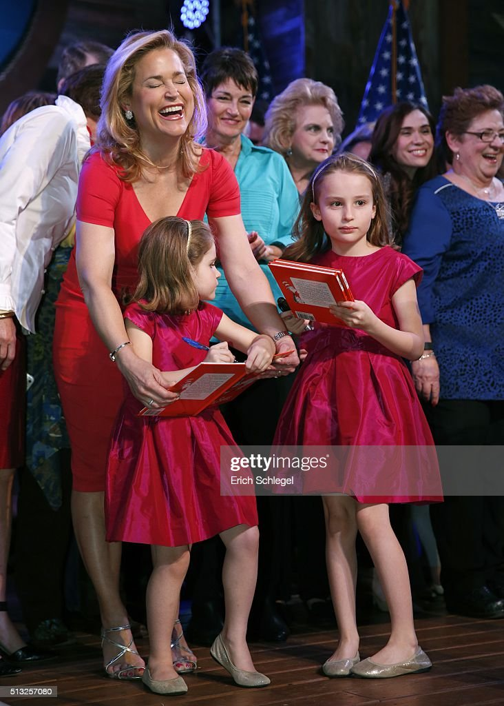 Heidi Cruz laughs as her daughters, Catherine (L) and Caroline autograph two Dr. Seuss books during a Super Tuesday watch party for husband, Republican presidential candidate, Sen. Ted Cruz (R-TX), at the Redneck Country Club March 1, 2016 in Stafford, Texas. Cruz won the Texas, Oklahoma, and Alaska primaries.