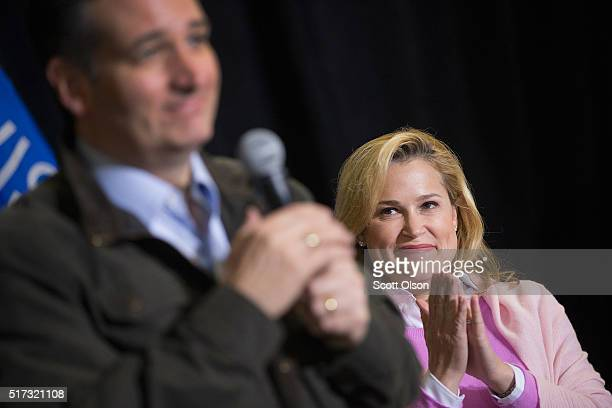 Heidi Cruz listens as her husband Republican presidential candidate Sen Ted Cruz speaks to workers at Dane Manufacturing during a campaign stop on...