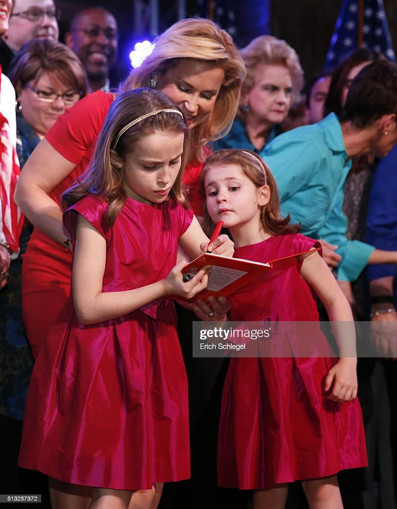 Heidi Cruz watches her daughters, Caroline (L) and Catherine autograph two Dr. Seuss books during a Super Tuesday watch party for Republican presidential candidate, Sen. Ted Cruz (R-TX), at the Redneck Country Club March 1, 2016 in Stafford, Texas. Cruz won the Texas, Oklahoma, and Alaska primaries.