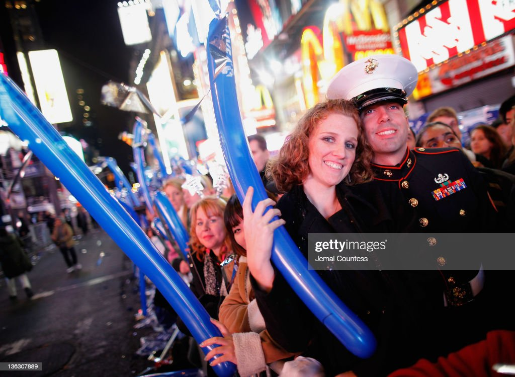Heidi Hyatt and Staff Sergent Nick Star join thousands of revelers gathered in New York's Times Square to celebrate the ball drop at the annual New Years Eve celebration on December 31, 2011 in New York City.