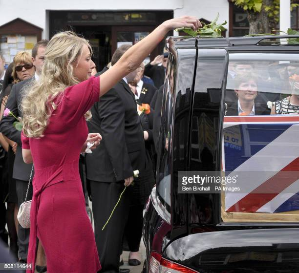Heidi Kirkpatrick the wife of Corporal Jamie Kirkpatrick of 101 Engineer Regiment places a single rose on the hearse carrying the coffin of her...