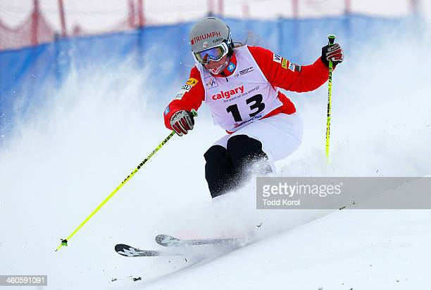 Heidi Kloser of the US competes during the women's moguls finals at the FIS Freestyle Ski World Cup January 4 2014 in Calgary Alberta Canada
