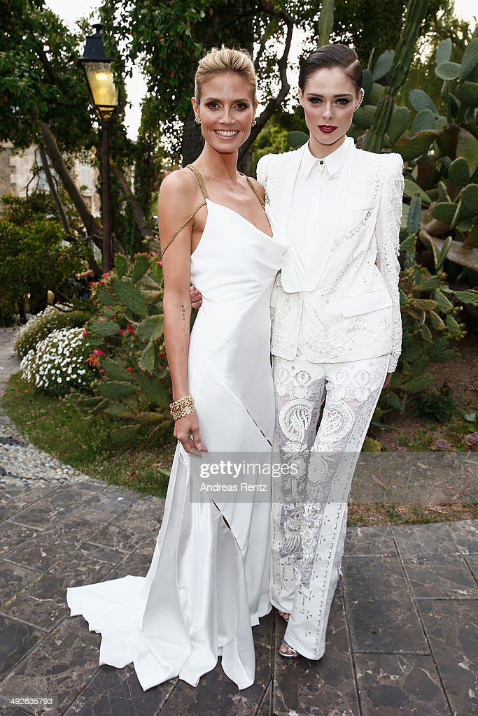 <a gi-track='captionPersonalityLinkClicked' href=/galleries/search?phrase=Heidi+Klum&family=editorial&specificpeople=178954 ng-click='$event.stopPropagation()'>Heidi Klum</a> and <a gi-track='captionPersonalityLinkClicked' href=/galleries/search?phrase=Coco+Rocha&family=editorial&specificpeople=4172514 ng-click='$event.stopPropagation()'>Coco Rocha</a> attend the Puerto Azul Experience at the 67th Annual Cannes Film Festival on May 21, 2014 in Cannes, France.