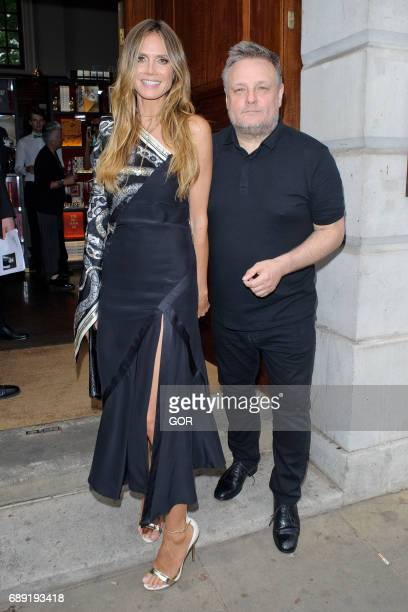 Heidi Klum and fashion photographer John Rankin arrive for a book launch party at Maison Assouline Piccadilly on May 27 2017 in London England