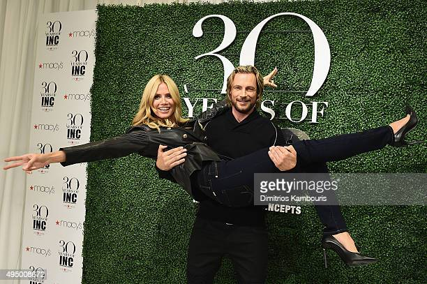 Heidi Klum and Gabriel Aubry attend the Glamour and INC International Concepts Denim Dash with Heidi Klum at Herald Square on October 30 2015 in New...