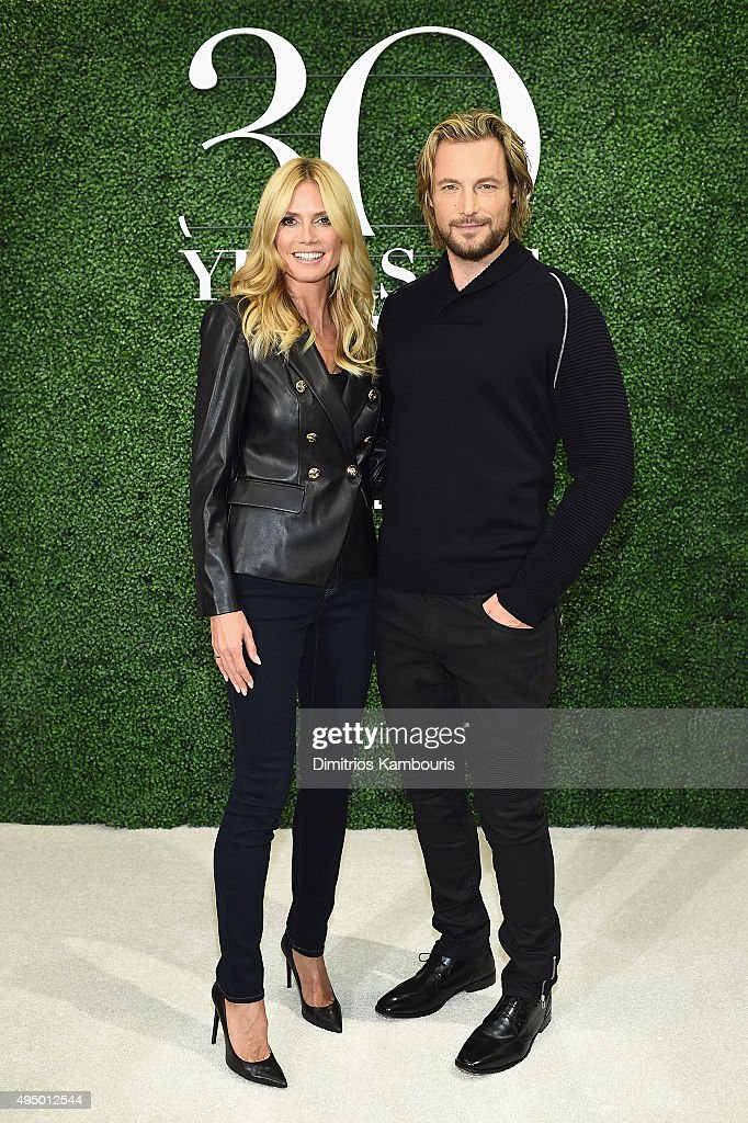 Heidi Klum (L) and Gabriel Aubry attend the Glamour and INC International Concepts Denim Dash with Heidi Klum at Herald Square on October 30, 2015 in New York City.