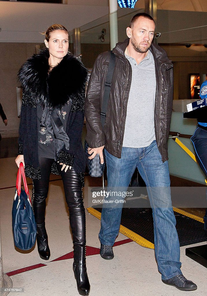 Heidi Klum and her boyfriend Martin Kristen are seen at Los Angeles International Airport on November 01 2012 in Los Angeles California