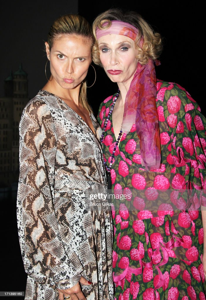 Heidi Klum and Jane Lynch as 'Miss Hannigan' pose backstage at the musical 'Annie' on Broadway at The Palace Theater on June 23 2013 in New York City