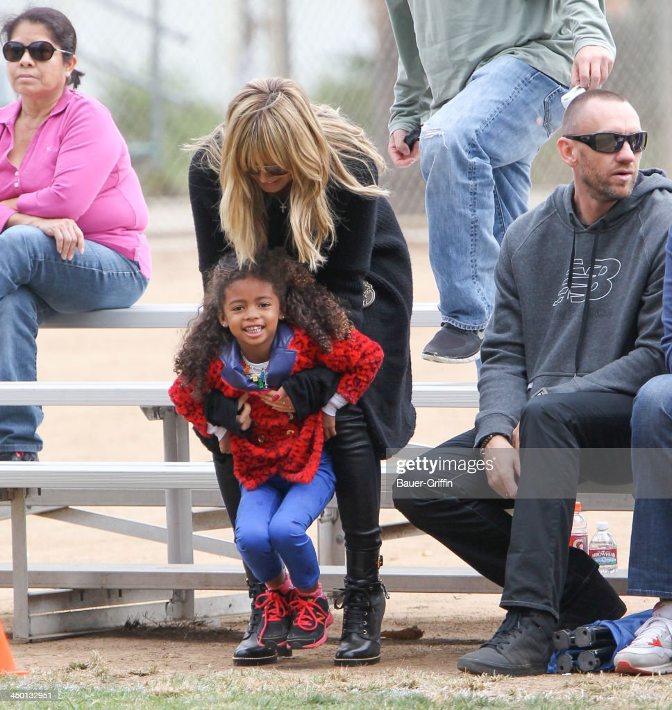 Heidi Klum and Martin Kristen with Lou Samuel are seen on November 16 2013 in Los Angeles California
