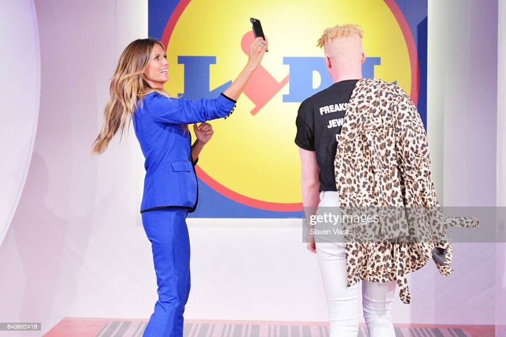 Heidi Klum (L) and model Shaun Ross walk the conveyor belt runway during the Esmara By Heidi Klum Lidl Fashion Presentation at New York Fashion Week #Letswow at ArtBeam on September 7, 2017 in New York City.