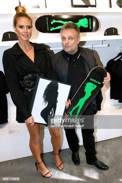 Heidi Klum and photographer John Rankin Waddell aka Rankin attend 'Heidi Klum by Rankin' Heidi Klum Rankin launch book at Supra Paris Store on May 26...