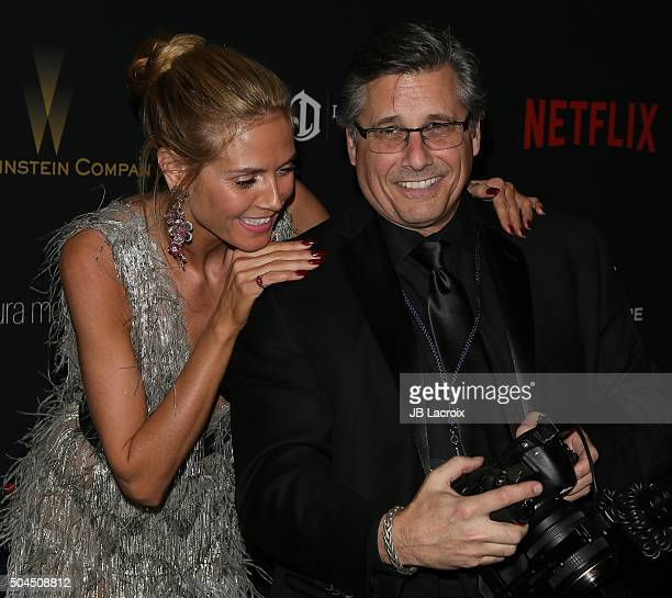 Heidi Klum and photographer Kevin Mazur attend The Weinstein Company and Netflix Golden Globe Party presented with DeLeon Tequila Laura Mercier Lindt...