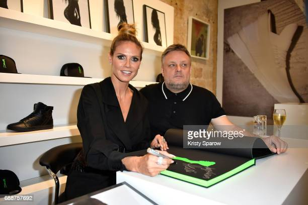 Heidi Klum and Photographer Rankin attend 'Heidi Klum by Rankin' Heidi Klum Rankin launch book at Supra Paris Store on May 26 2017 in Paris France